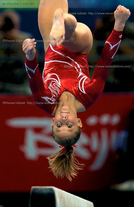 United States Women's Gymnastics team members  Shawn Johnson (411) performed a near flawless routine on the balance beam helping her team win the Silver Medal  in the Women's Team Gymnastics Final. Photograph by Vincent Laforet for NEWSWEEK