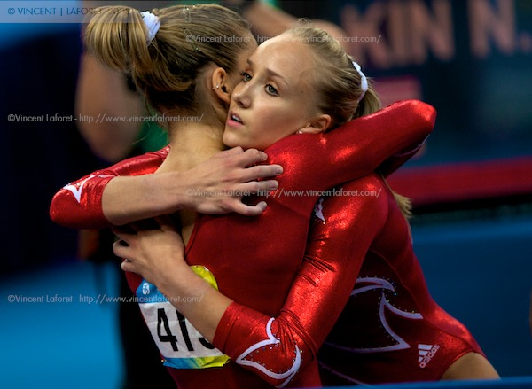 United States Women's Gymnastics team member Nastia Liukin (412) consoles teammate Alicia Sacramone (415) who fell twice in the competition at the conclusion of the Women's Team Gymnastics Final where the narrowly missed the Gold Medal - coming in with Silver.  Photograph by Vincent Laforet for NEWSWEEK