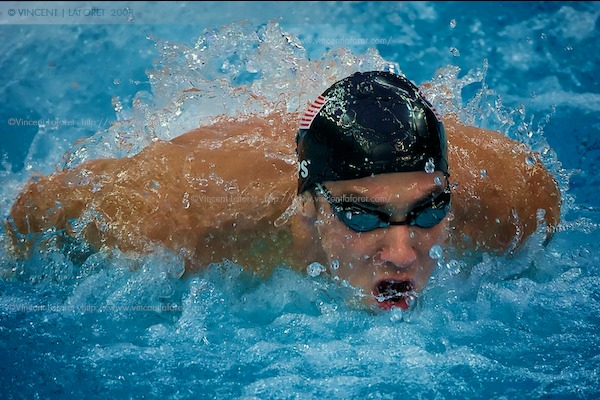Michael Phelps in action swimming the butterfly stroke in third position - this shot was made with a Canon 1D MKIII and an 800mm 5.6 at 1/640th of a second.  Photograph by Vincent Laforet for NEWSWEEK