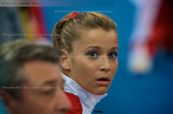 Alicia Sacramone reacts as she watches her Bronze medal disappear as she falls in the ranking of the women's individual vault competition.