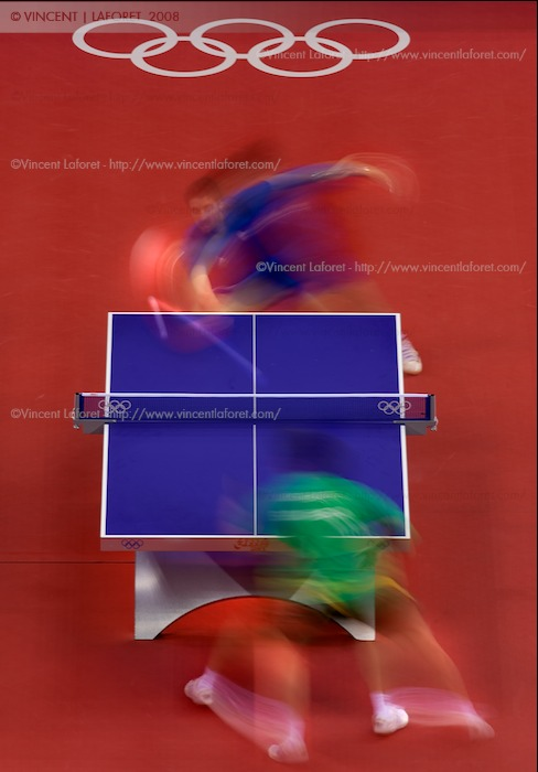 Tsuboi Gustavo of Brazil (bottom) and Peter-Paul Pradeeban of Canada playing table tennis in this long exposure from overhead. Photograph by Vincent Laforet for NEWSWEEK