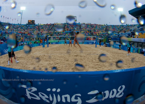 China's Chen Xue and Xi Zhand defeated the Brazilian team and won the bronze medal in the women's beach volleyball game. I made this image with a 15mm fisheye lens set to f22 in an attempt to accentuate the raindrops and absolutely miserable conditions.  Photo by Vincent Laforet for NEWSWEEK