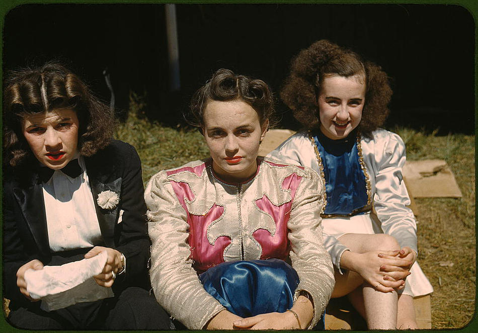 "Backstage at the ""girlie"" show at the state fair. Rutland, Vermont, September 1941. Reproduction from color slide. Photo by Jack Delano. Prints and Photographs Division, Library of Congress"